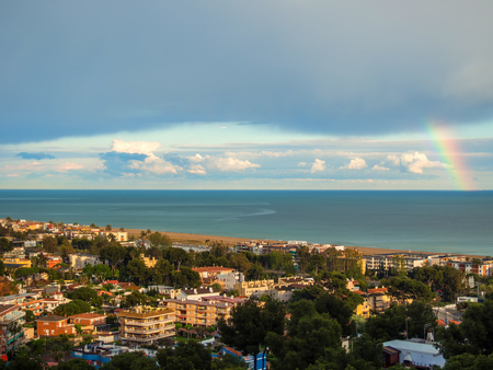 aerial views of the beach of Castelldefels after a storm and with the rainbow