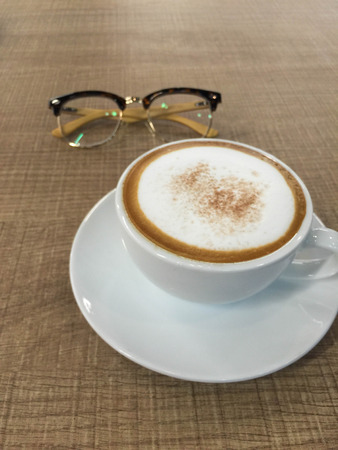 Cup of coffee on wooden table with glasses Stok Fotoğraf