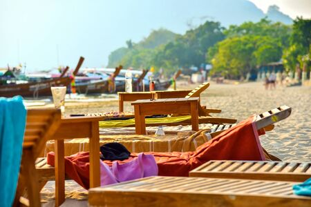 Beach with sunbed at tropical beach. Relax deck chair vacation. Reklamní fotografie