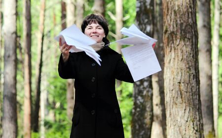 average age: Woman throwing sheets of paper