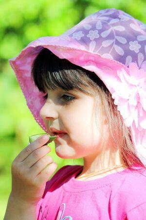 eats: girl eats Stock Photo