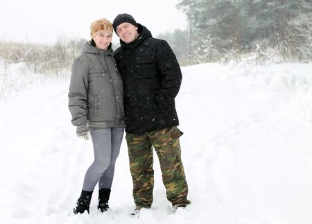 average age: a couple on the snow Stock Photo