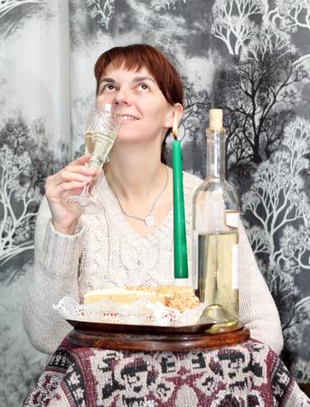 median age: woman drinking wine Stock Photo