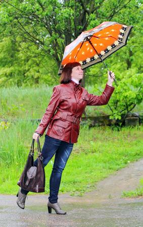 lighthearted: woman under an umbrella