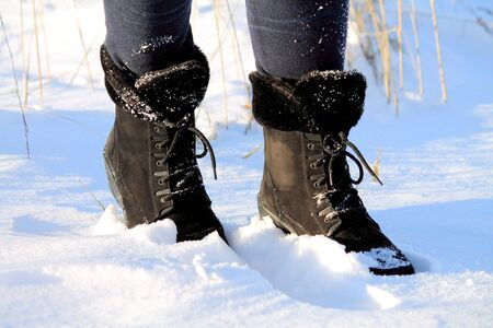 feet in shoes in the snow Stock Photo