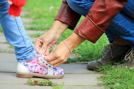 children s feet: lace up a shoe Stock Photo