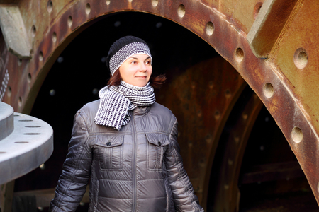 A woman at an old factory Фото со стока