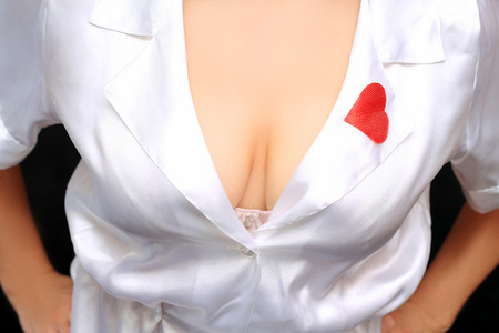 a woman's breast in a dressing-gown Archivio Fotografico