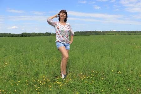 woman among green field in summer