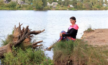 woman on a walk by the river