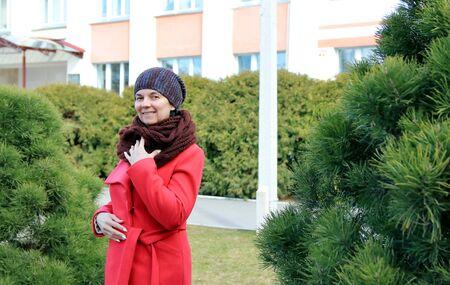 woman in a coat on a walk Фото со стока