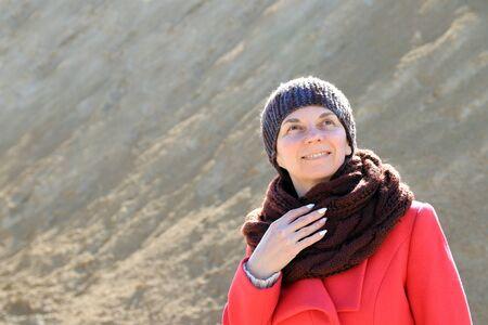 woman in a coat on a walk