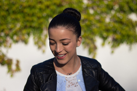 leather jacket: Young woman in leather jacket