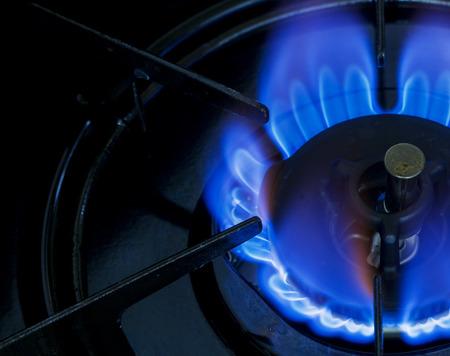 gas stove: Gas Stove Burner Blue Flame Stock Photo