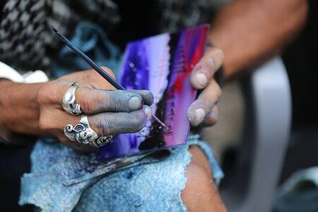 artisan: painting brush hands