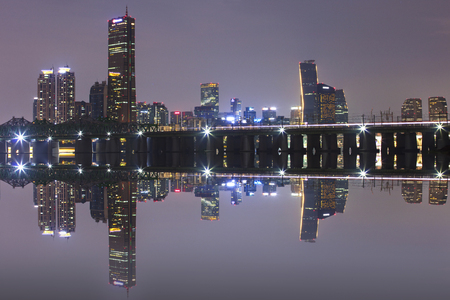 Seoul City Skyline and Han river with Railway bridge at night.