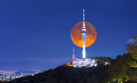 Super full Moon with Seoul tower at night in Seoul, South Korea. Stock Photo