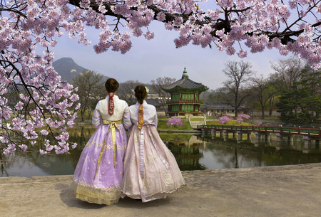 Cherry Blossom in spring with Korean national dress at Gyeongbokgung Palace  Seoul,South Korea. Imagens