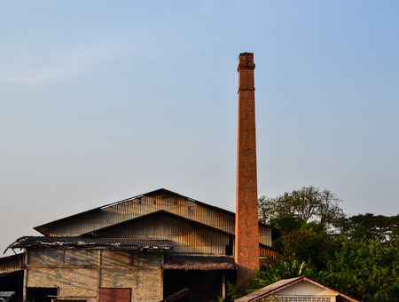 rice mill: Old brick chimney is located in a rice mill. Stock Photo