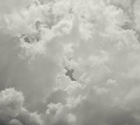 ominous: Dark ominous gray storm clouds. Dramatic sky.