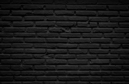 Old black Brick Wall. Seamless Tileable Texture.
