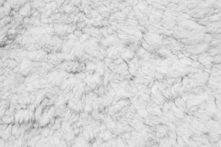 Luxurious wool texture from a gray sheepskin rug