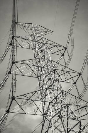 pylon: Electricity pylon against cloudy sky Stock Photo