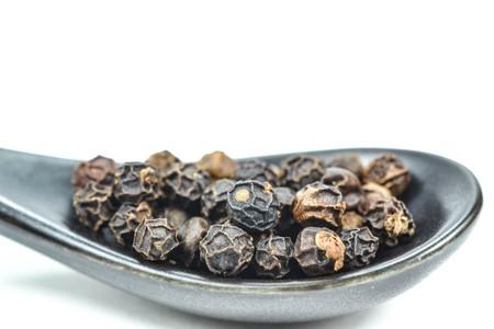 peppercorn: spoon full of black peppercorn