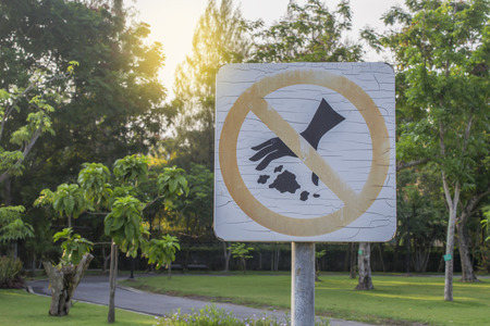 public waste: Do not waste warning signs in the park. Stock Photo
