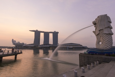 The Merlion fountain spouts water in front of Marina Bay Sand