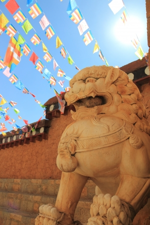 Stone Lion sculpture and the sun, symbol of protection   power photo