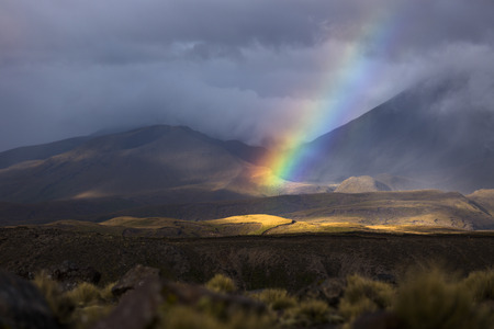 Beautiful mountain rainbow in Tongariro national park, New zealandsunlight shine on the mountain and rainbow photo