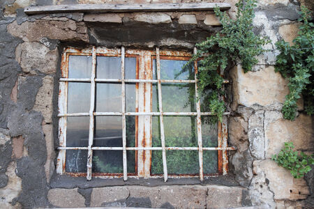 old and rusty Window with reflection  photo