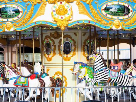 The carousel in the funfair park festival.