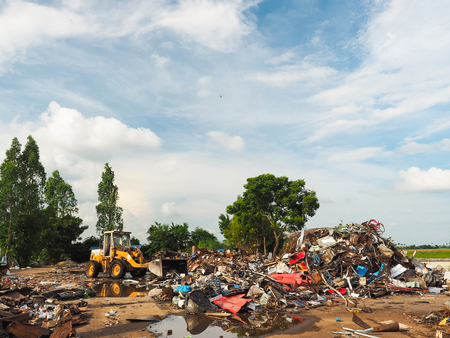 dump yard: The metal scrap in junkyard are recycling.
