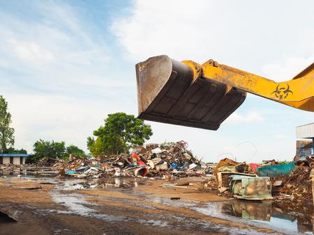 metal scrap: The metal scrap in junkyard are recycling.