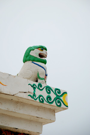 Close up to the sculpture on top of the roof Фото со стока