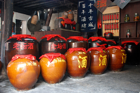 wine jars at Fenghuang Ancient City Редакционное