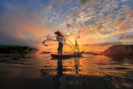 similar images preview: Preview Save to a lightbox  Find Similar Images  Share Stock Photo: Fisherman of Mekong River in action when fishing, Thailand