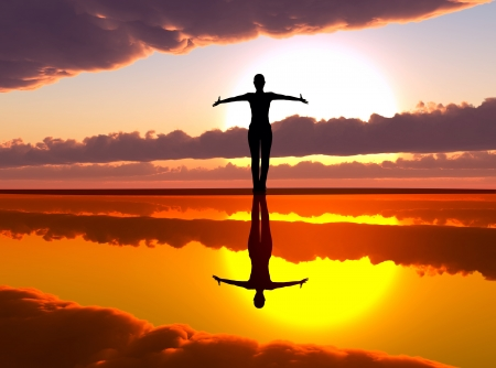 Woman welcoming the sunrise praising the day Stock Photo