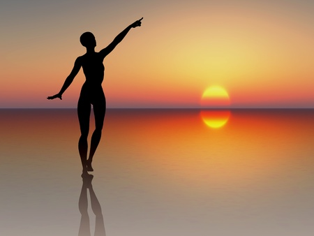 Woman reaching for the rising sun. Silhouette of a young woman stands for success, power, goal-setting, motivation photo