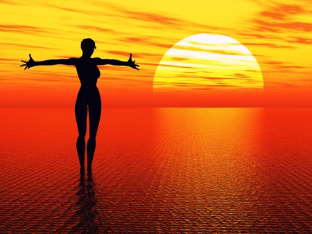 Good morning sunshine. Praying woman reaching for the rising sun