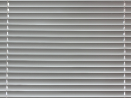 Fragment of window plastic blinds photo