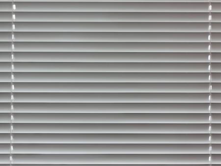 Fragment of window plastic blinds