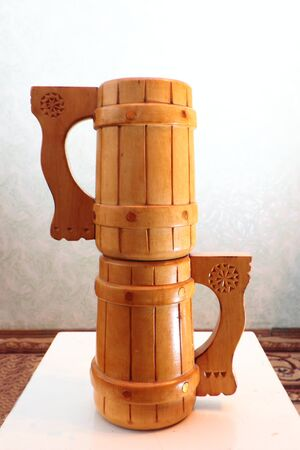 wooden stool: Two wooden mugs on a stool  Stock Photo