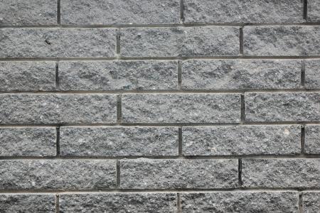 buffed: Plot structure of the stone blocks of dark, rectangularroughly buffed  Stock Photo