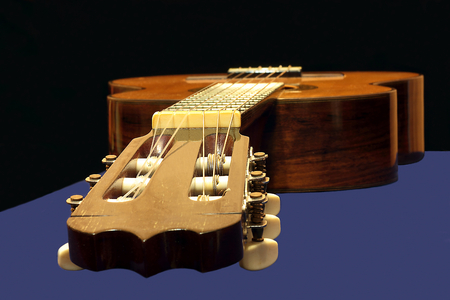 classical mechanics: Focus on the mechanics of six-string classical musical instrument