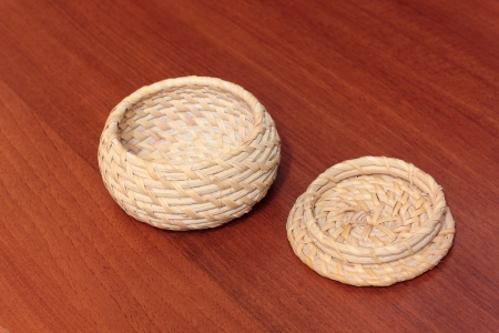 Wicker container with a lid for storage of any items, knickknacks, various household objects photo