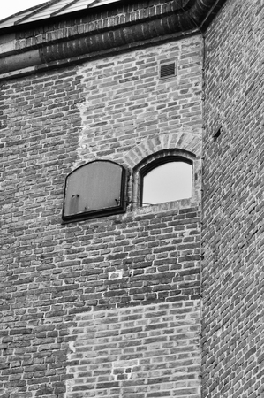 Inspection window with metal shutters in the outer wall. photo