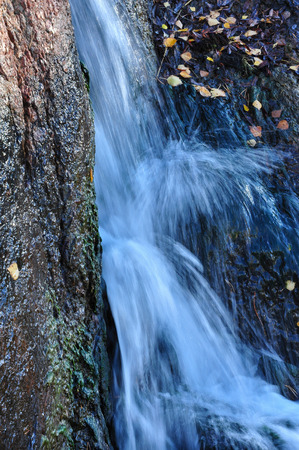 rapidly: Blue flows rapidly descend the great natural stones. Stock Photo